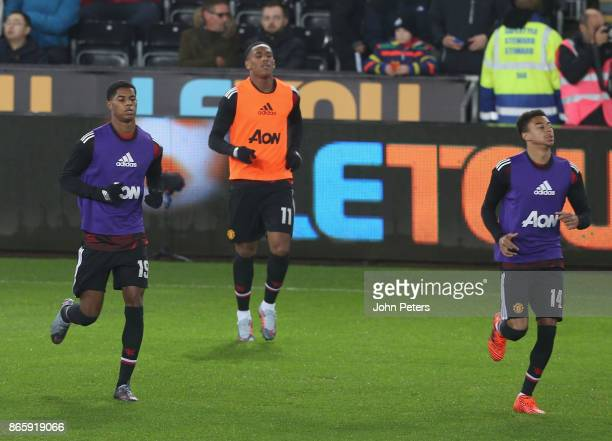 Marcus Rashford Anthony Martial and Jesse Lingard of Manchester United warm up ahead of the Carabao Cup Fourth Round match between Swansea City and...