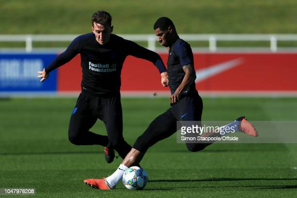 Marcus Rashford battles with Lewis Dunk during an England training session at St George's Park on October 9 2018 in BurtonuponTrent England