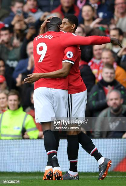 Marcus Rashford celebrates scoring his side's first goal with Romelu Lukaku of Manchester United during the Premier League match between Manchester...