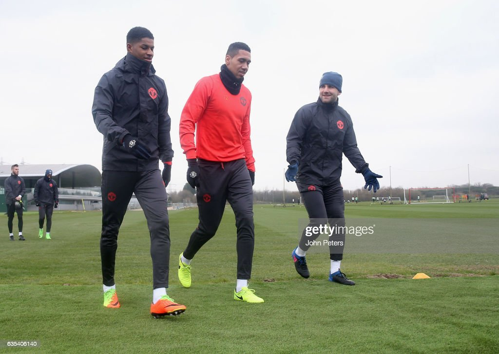 Marcus Rashford, Chris Smalling and Luke Shaw of Manchester United in action during a first team training session at Aon Training Complex on February 15, 2017 in Manchester, England.