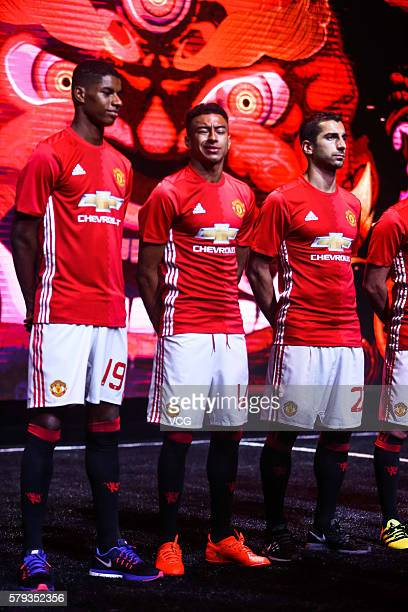 Marcus Rashford Jesse Lingard and Henrikh Mkhitaryan of Manchester United pose during the official launch of the 2016/17 Manchester United home kit...