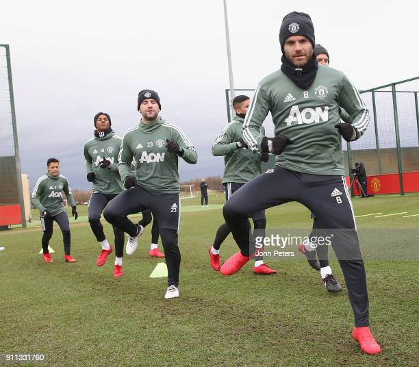 Marcus Rashford Luke Shaw and Juan Mata of Manchester United in action during a first team training session at Aon Training Complex on January 28...