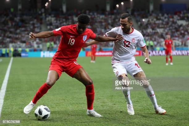 Marcus Rashford of England and Ali Maaloul of Tunisia battle for the ball during the 2018 FIFA World Cup Russia group G match between Tunisia and...