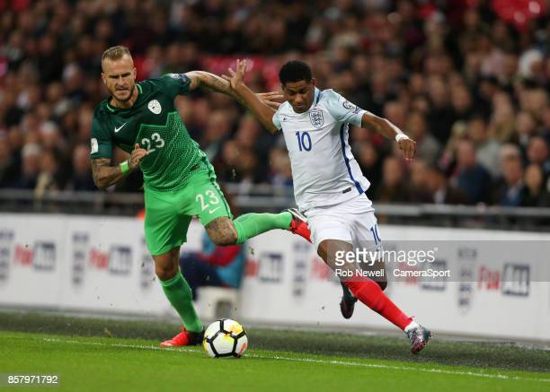 Marcus Rashford of England and Aljaz Struna of Slovenia during the FIFA 2018 World Cup Qualifier between England and Slovenia at Wembley Stadium on...
