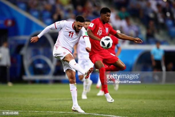 Marcus Rashford of England and Dylan Bronn of Tunisia in action during the 2018 FIFA World Cup Russia group G match between Tunisia and England at...