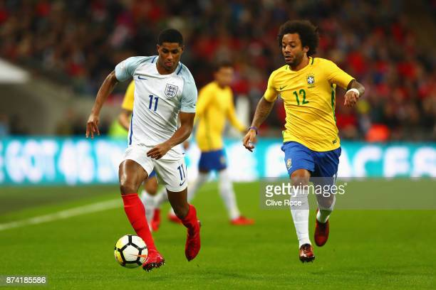 Marcus Rashford of England and Marcelo of Brazil battle for possession during the international friendly match between England and Brazil at Wembley...