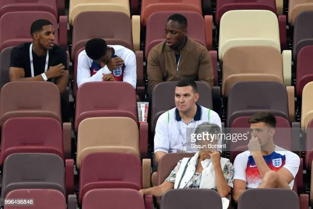 Marcus Rashford of England and Nick Pope of England are consoled by their families following England's defeat in the 2018 FIFA World Cup Russia Semi...