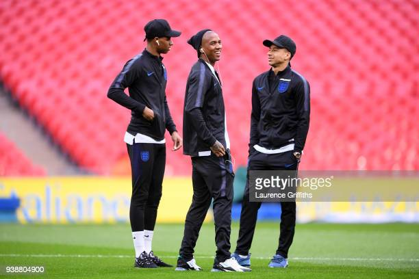 Marcus Rashford of England Ashley Young of England and Jesse Lingard of England take a look around the pitch prior to the International friendly...
