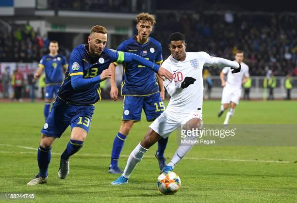 Marcus Rashford of England battles for possession with Mergim Vojvoda and Amir Rrahmani of Kosovo during the UEFA Euro 2020 Qualifier between Kosovo...
