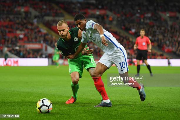 Marcus Rashford of England battles with Aljaz Struna of Slovenia during the FIFA 2018 World Cup Group F Qualifier between England and Slovenia at...
