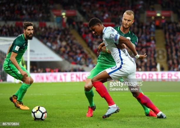 Marcus Rashford of England battles with Aljaz Struna of Slovenia during the FIFA 2018 World Cup Qualifier between England and Slovenia at Wembley...