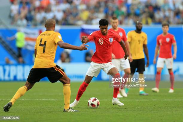 Marcus Rashford of England battles with Vincent Kompany of Belgium during the 2018 FIFA World Cup Russia 3rd Place Playoff match between Belgium and...