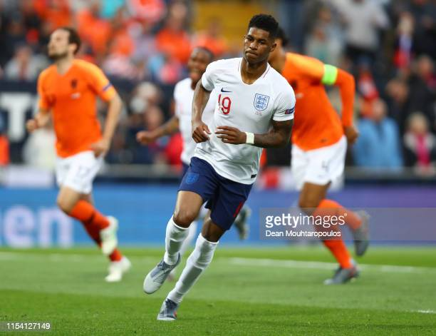 Marcus Rashford of England celebrates as he scores his team's first goal from a penalty during the UEFA Nations League SemiFinal match between the...