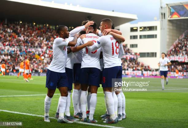 Marcus Rashford of England celebrates as he scores his team's first goal from a penalty with team mates during the UEFA Nations League SemiFinal...