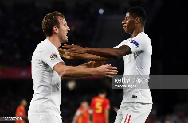 Marcus Rashford of England celebrates as he scores his team's second goal with Harry Kane of England during the UEFA Nations League A Group Four...