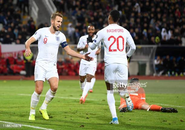 Marcus Rashford of England celebrates scoring his team's third goal with Harry Kane during the UEFA Euro 2020 Qualifier between Kosovo and England at...