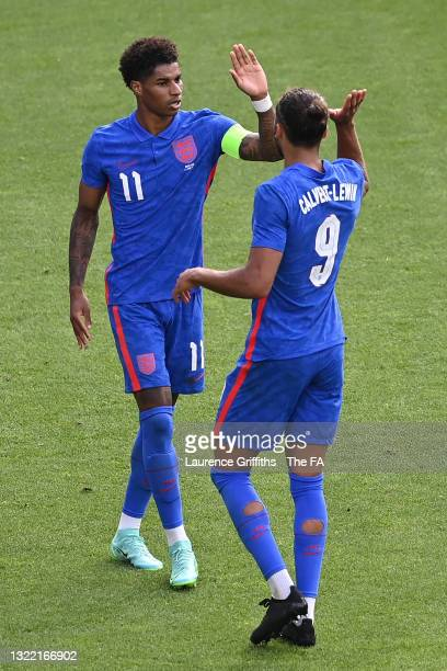 Marcus Rashford of England celebrates with Dominic Calvert-Lewin after scoring their side's first goal during the international friendly match...