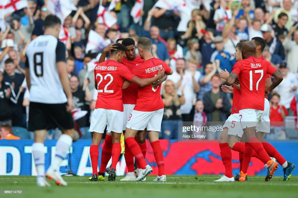 Marcus Rashford of England celebrates with Jordan Henderson and Trent Alexander-Arnold of England during the International Friendly match between England and Costa Rica at Elland Road on June 7, 2018 in Leeds, England.