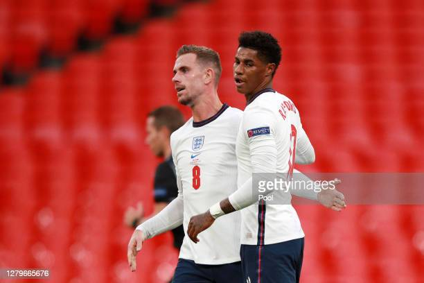 Marcus Rashford of England celebrates with Jordan Henderson of England after scoring his sides first goal from the penalty spot during the UEFA...