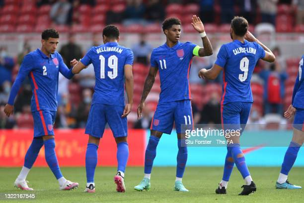Marcus Rashford of England celebrates with team mate Dominic Calvert-Lewin after scoring their side's first goal from the penalty spot during the...