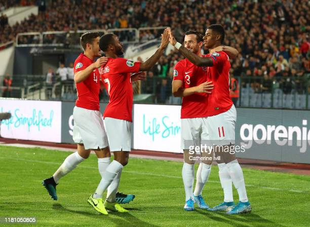 Marcus Rashford of England celebrates with team mates after he scores his sides first goal during the UEFA Euro 2020 qualifier between Bulgaria and...