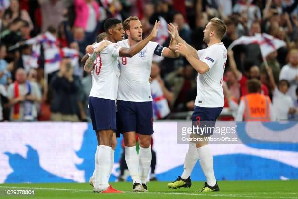 Marcus Rashford of England celebrates with teammates Harry Kane of England and Luke Shaw of England after scoring their 1st goal during the UEFA...