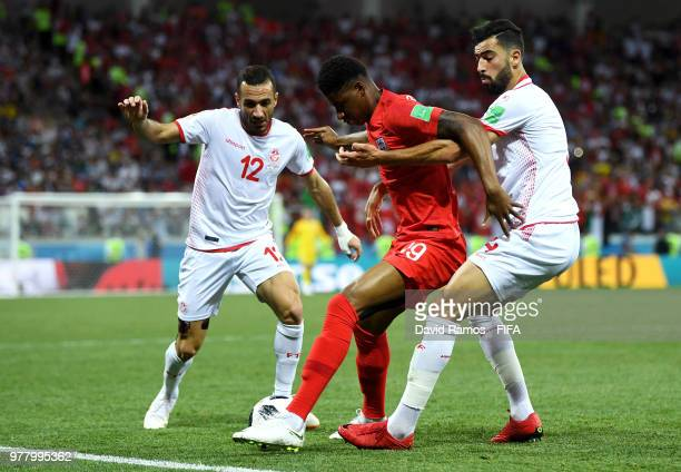 Marcus Rashford of England challenge for the ball with Yassine Meriah and Ali Maaloul of Tunisia during the 2018 FIFA World Cup Russia group G match...