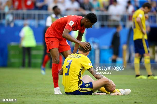 Marcus Rashford of England consoles Manchester United teammate Victor Lindelof of Sweden following the 2018 FIFA World Cup Russia Quarter Final match...