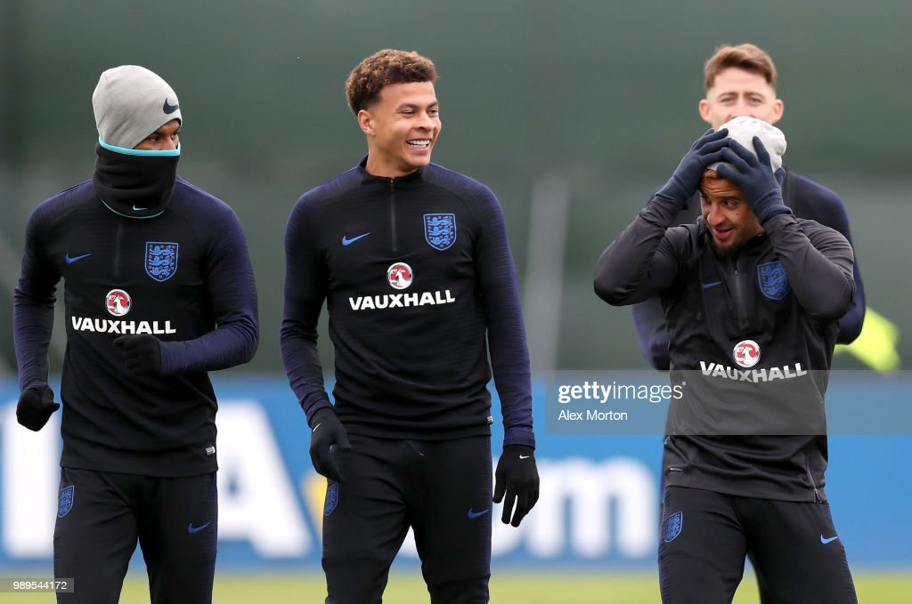 Marcus Rashford of England, Dele Alli of England and Kyle Walker of England share a joke during the England training session at the Stadium Spartak Zelenogorsk on July 2, 2018 in Saint Petersburg, Russia.