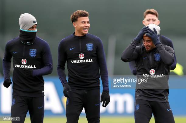 Marcus Rashford of England Dele Alli of England and Kyle Walker of England share a joke during the England training session at the Stadium Spartak...