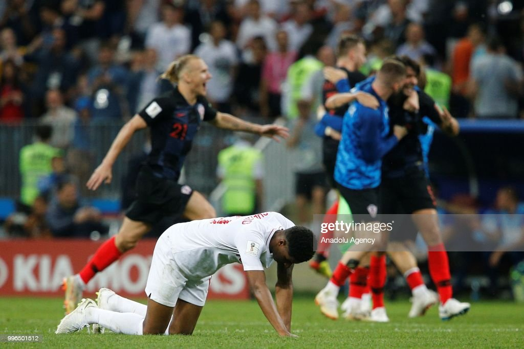 Marcus Rashford of England gets upset as players of Croatia celebrate after the 2018 FIFA World Cup Russia Semi Final match between England and Croatia at Luzhniki Stadium on July 11, 2018 in Moscow, Russia. Croatia have advanced to their first ever World Cup final after beating England 2-1.