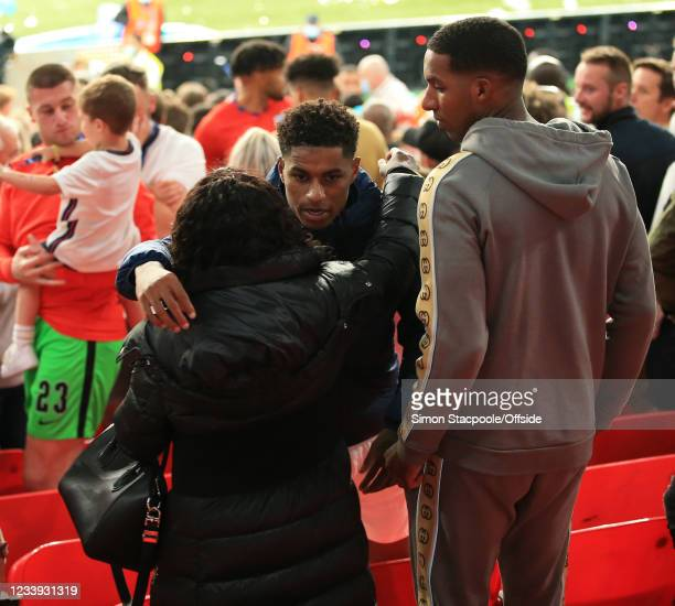 Marcus Rashford of England hugs his mother after the UEFA Euro 2020 Championship Final between Italy and England at Wembley Stadium on July 11, 2021...
