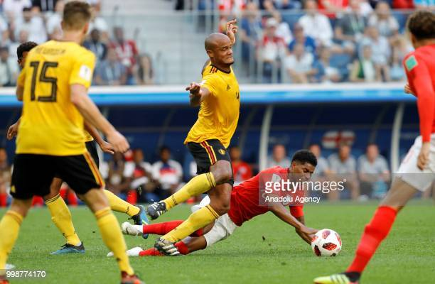 Marcus Rashford of England in action against Vincent Kompany of Belgium during the 2018 FIFA World Cup 3rd place match between Belgium and England at...