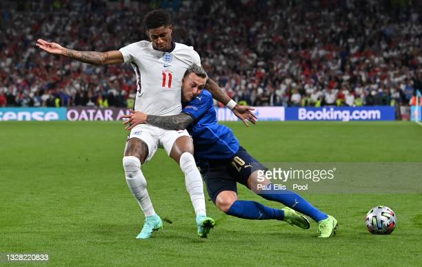 Marcus Rashford of England is challenged by Federico Bernardeschi of Italy during the UEFA Euro 2020 Championship Final between Italy and England at...
