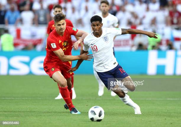 Marcus Rashford of England is challenged by Leander Dendoncker of Belgium during the 2018 FIFA World Cup Russia group G match between England and...