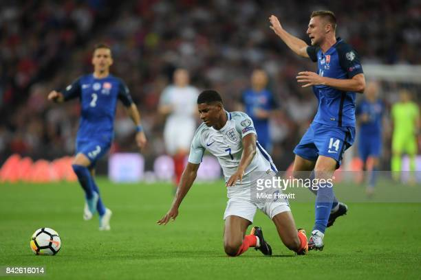 Marcus Rashford of England is challenged by Milan Skriniar of Slovakia during the FIFA 2018 World Cup Qualifier between England and Slovakia at...
