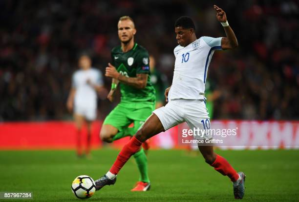 Marcus Rashford of England is chased by Aljaz Struna of Slovenia during the FIFA 2018 World Cup Group F Qualifier between England and Slovenia at...