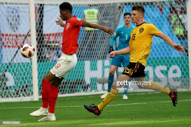 Marcus Rashford of England is checked by Thomas Meunier of Belgium during the 2018 FIFA World Cup Russia 3rd Place Playoff match between Belgium and...