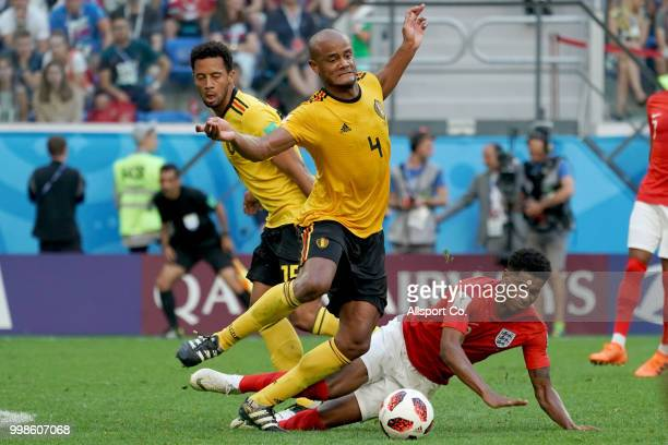 Marcus Rashford of England is checked by Vincent Kompany of Belgium during the 2018 FIFA World Cup Russia 3rd Place Playoff match between Belgium and...