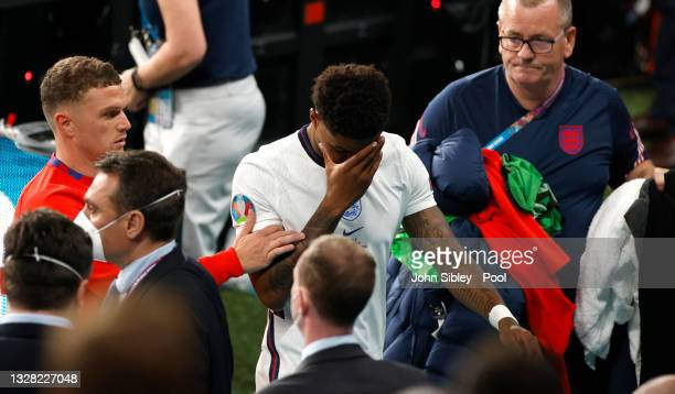 Marcus Rashford of England is consoled by team mate Kieran Trippier after the penalty shoot out after the UEFA Euro 2020 Championship Final between...