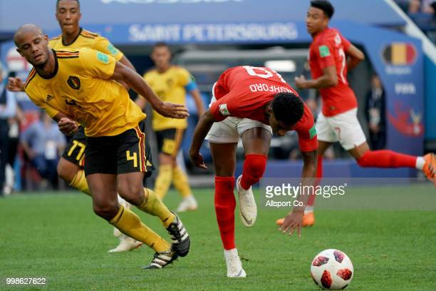 Marcus Rashford of England is fouled by Vincent Kompany of Belgium during the 2018 FIFA World Cup Russia 3rd Place Playoff match between Belgium and...