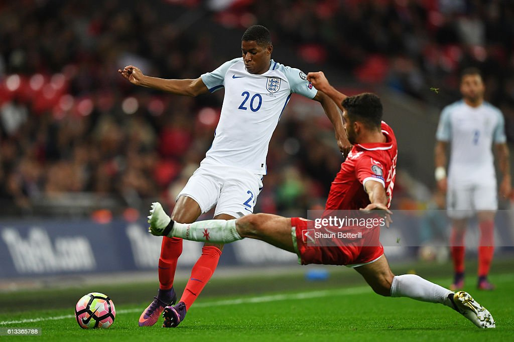 Marcus Rashford of England is tackled by Joseph Zerafa of Malta during the FIFA 2018 World Cup Qualifier Group F match between England and Malta at Wembley Stadium on October 8, 2016 in London, England.