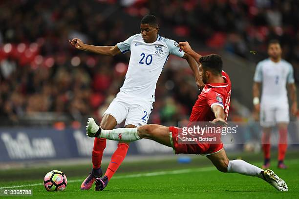 Marcus Rashford of England is tackled by Joseph Zerafa of Malta during the FIFA 2018 World Cup Qualifier Group F match between England and Malta at...