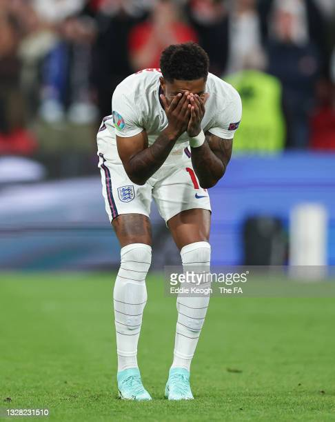 Marcus Rashford of England looks dejected after missing their team's third penalty in a penalty shoot out during the UEFA Euro 2020 Championship...