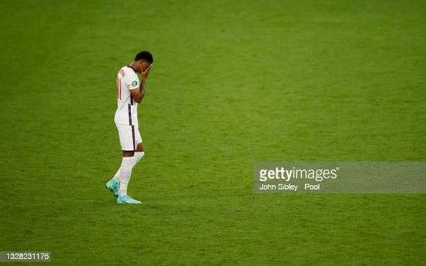 Marcus Rashford of England reacts after missing their team's third penalty in the penalty shoot out during the UEFA Euro 2020 Championship Final...