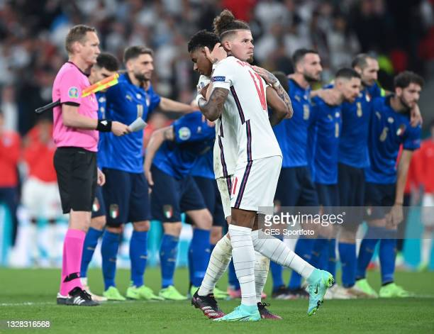 Marcus Rashford of England reacts with Kalvin Phillips after his penalty miss during the UEFA Euro 2020 Championship Final between Italy and England...