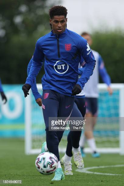 Marcus Rashford of England runs with the ball during the England Training Session at Tottenham Hotspur Training Ground on June 20, 2021 in Burton...