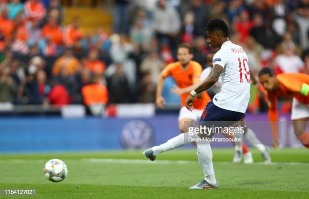 Marcus Rashford of England scores his team's first goal from a penalty during the UEFA Nations League SemiFinal match between the Netherlands and...