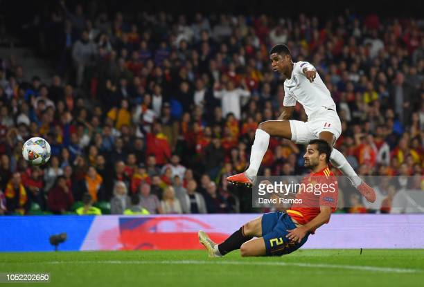 Marcus Rashford of England scores his team's second goal as Jonny of Spain challenges during the UEFA Nations League A Group Four match between Spain...