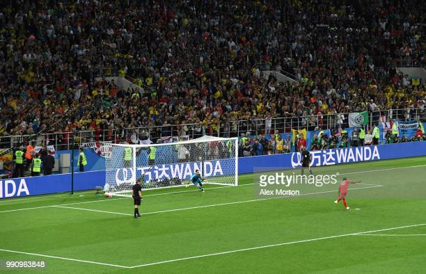 Marcus Rashford of England scores his team's second penalty in the penalty shoot out during the 2018 FIFA World Cup Russia Round of 16 match between...